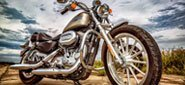 Brightly Polished Harley-Davidson Motorcycle with a Threatening Sky in the Background